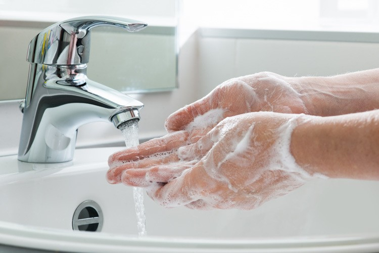 Washing hands to minimise spread of infection