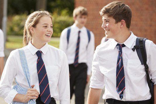 Pupils walking across school playground