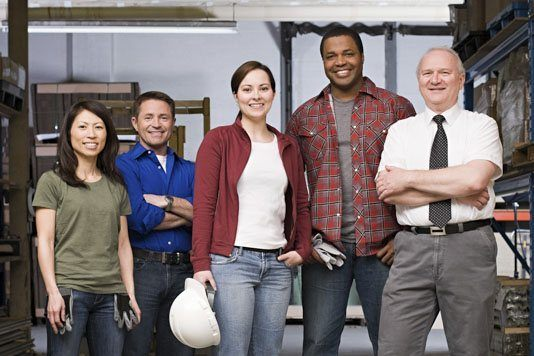 Team of workplace first-aiders in their warehouse